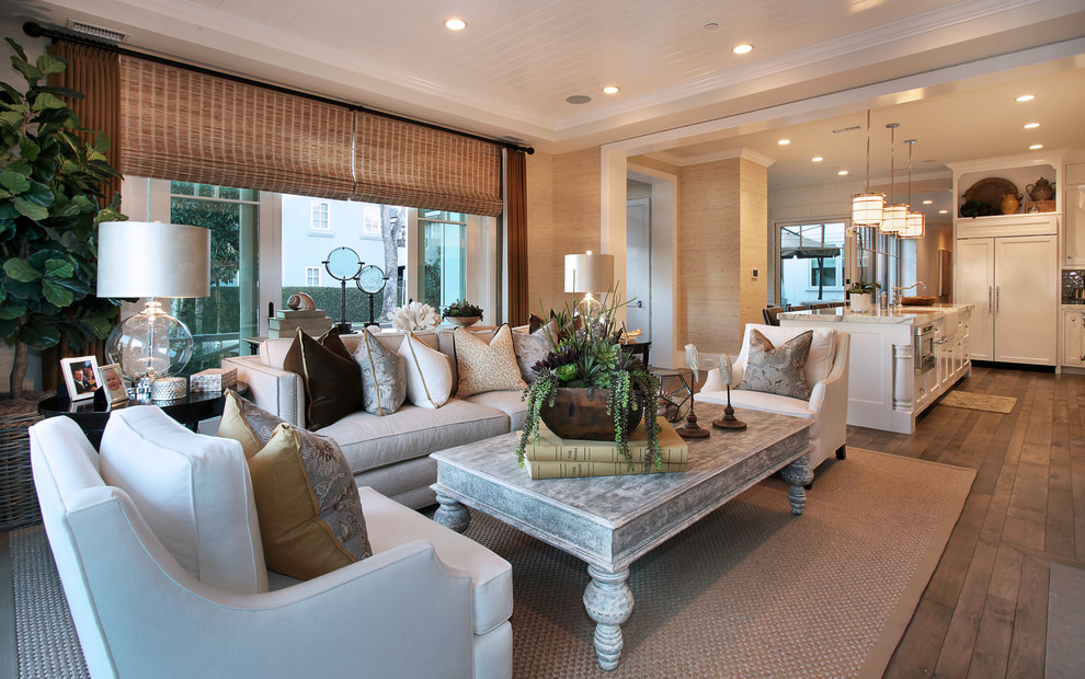 Inspiration for a timeless open concept living room remodel in Orange County with beige walls