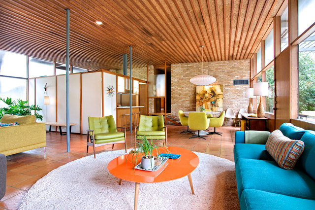 1960s terra-cotta floor and orange floor living room photo in Austin