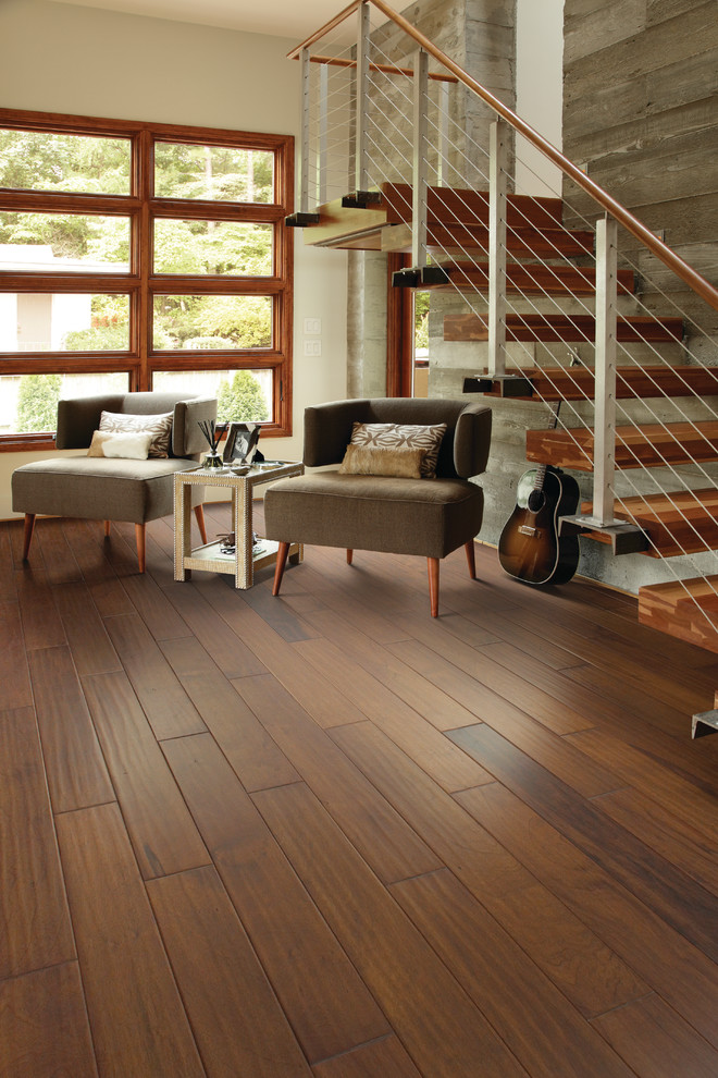 Large trendy open concept medium tone wood floor living room photo in Jacksonville with beige walls and no tv