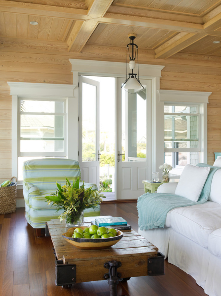 Beach style medium tone wood floor living room photo in Miami with no fireplace