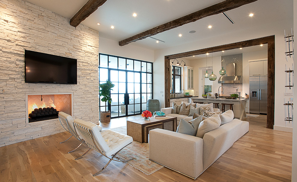 Living room - transitional open concept beige floor living room idea in Austin with a wall-mounted tv