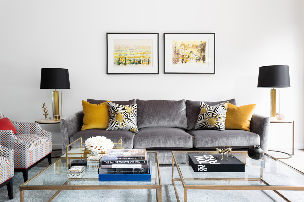 Photo of a transitional living room in Melbourne with white walls.