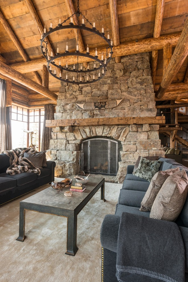 Inspiration for a rustic formal living room remodel in Other with a standard fireplace, a stone fireplace and no tv