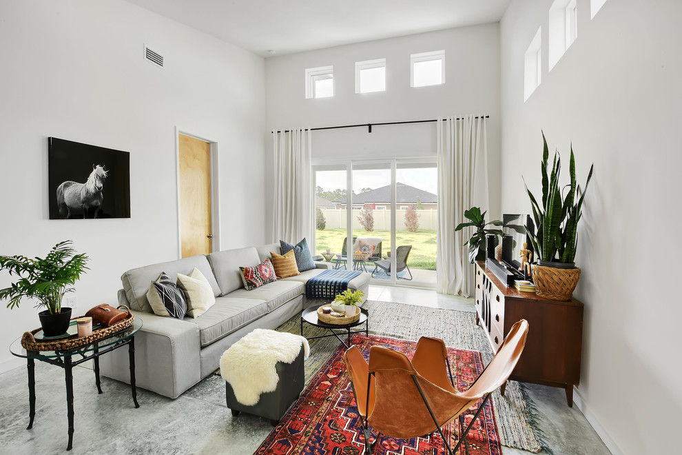 Living room - mid-sized modern open concept concrete floor and gray floor living room idea in Jacksonville with white walls, no fireplace and a tv stand