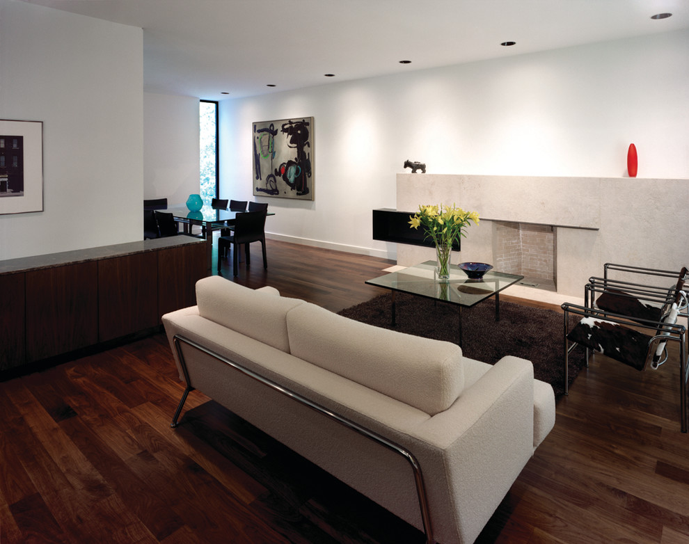 Trendy open concept living room photo in Toronto with white walls