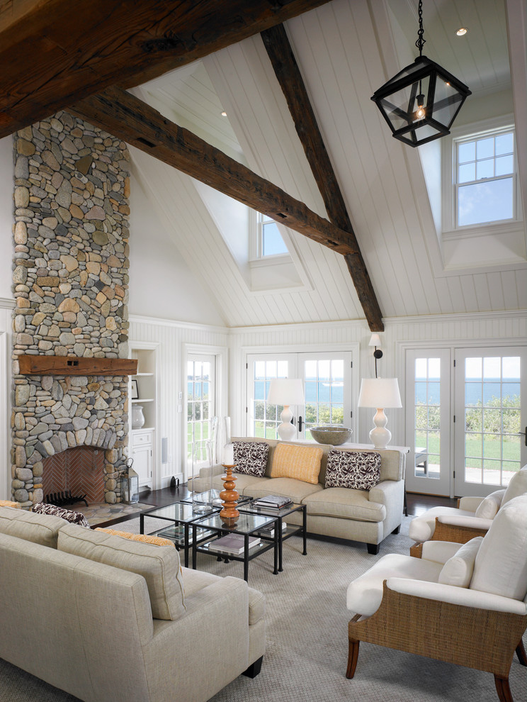 Inspiration for a large coastal open concept dark wood floor living room remodel in Boston with white walls, a standard fireplace and a stone fireplace