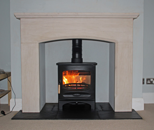 Charnwood c5 wood burning stove with limestone mantel and slate tiled hearth contemporary for Living room with wood burning stove
