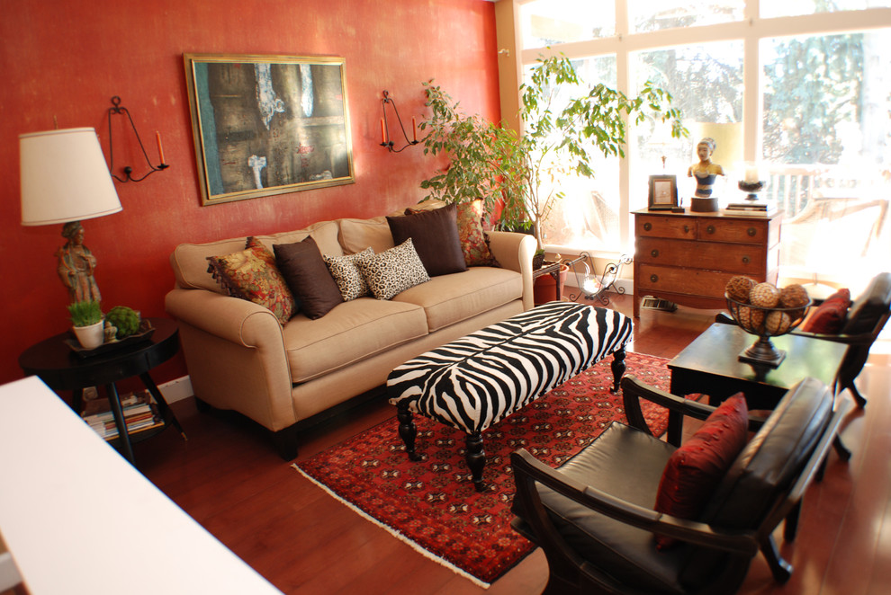 Eclectic living room photo in Boise with red walls