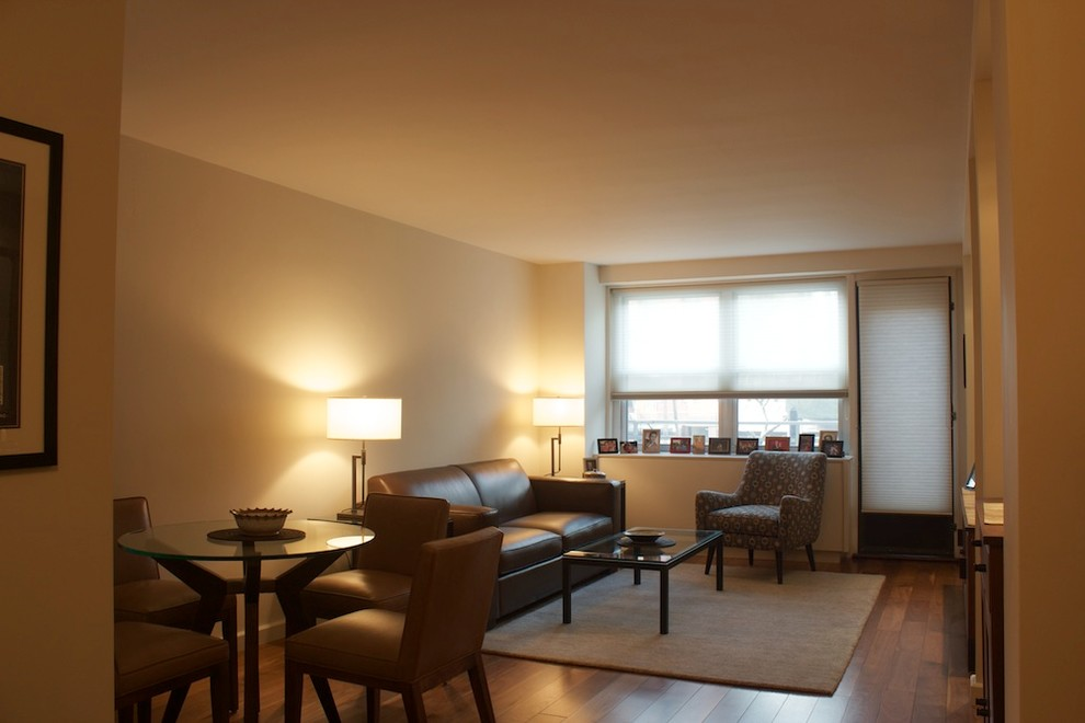 Example of a small eclectic open concept medium tone wood floor living room design in New York with beige walls