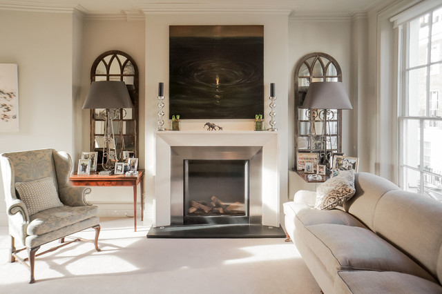 Inspiration for a medium sized classic formal living room in London with beige walls, a standard fireplace, no tv, a metal fireplace surround and carpet.