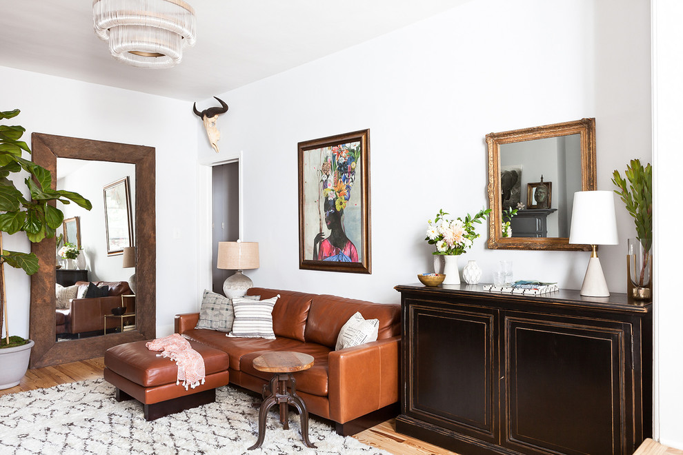 Inspiration for a small eclectic formal and open concept light wood floor and beige floor living room remodel in New York with white walls and no tv