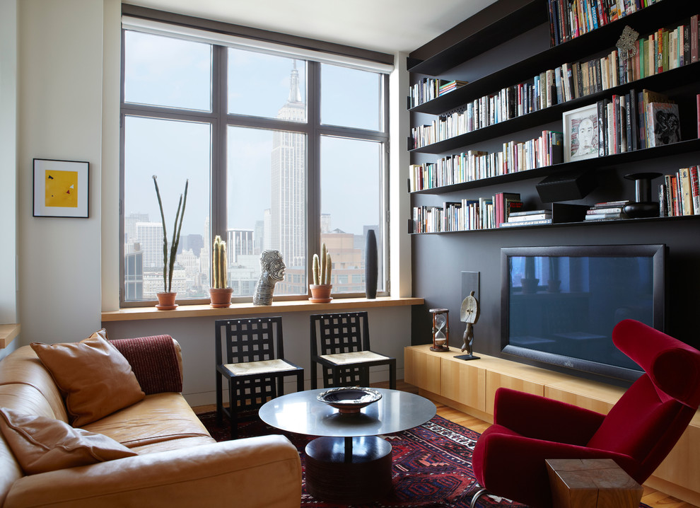 Inspiration for a small contemporary enclosed light wood floor living room remodel in New York with black walls and no fireplace