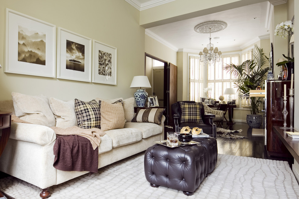 Inspiration for a classic enclosed living room in London with beige walls.