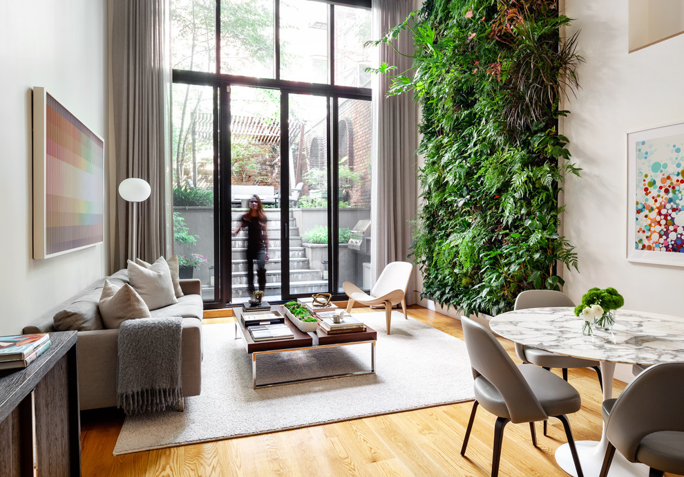 Danish open concept medium tone wood floor living room photo in New York with white walls, no fireplace and no tv