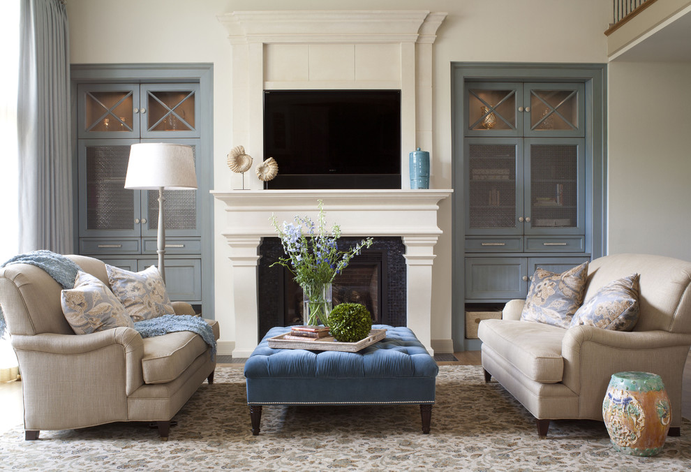 Example of a transitional formal living room design in Denver with a standard fireplace