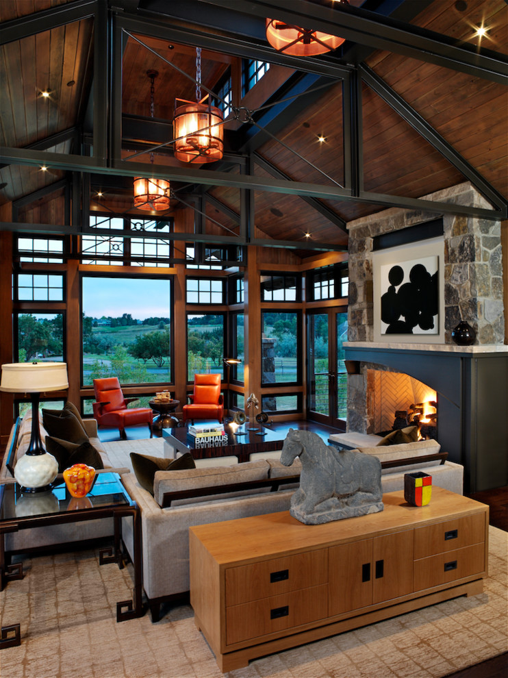 Living room - large contemporary open concept dark wood floor living room idea in Denver with a standard fireplace, a stone fireplace, brown walls and no tv