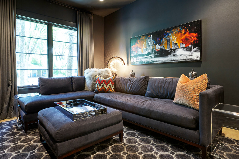 Trendy light wood floor living room photo in Austin with black walls