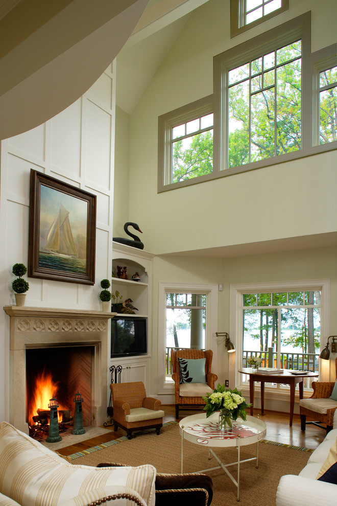 Inspiration for a huge coastal formal and open concept medium tone wood floor living room remodel in Philadelphia with yellow walls, a standard fireplace, a stone fireplace and no tv