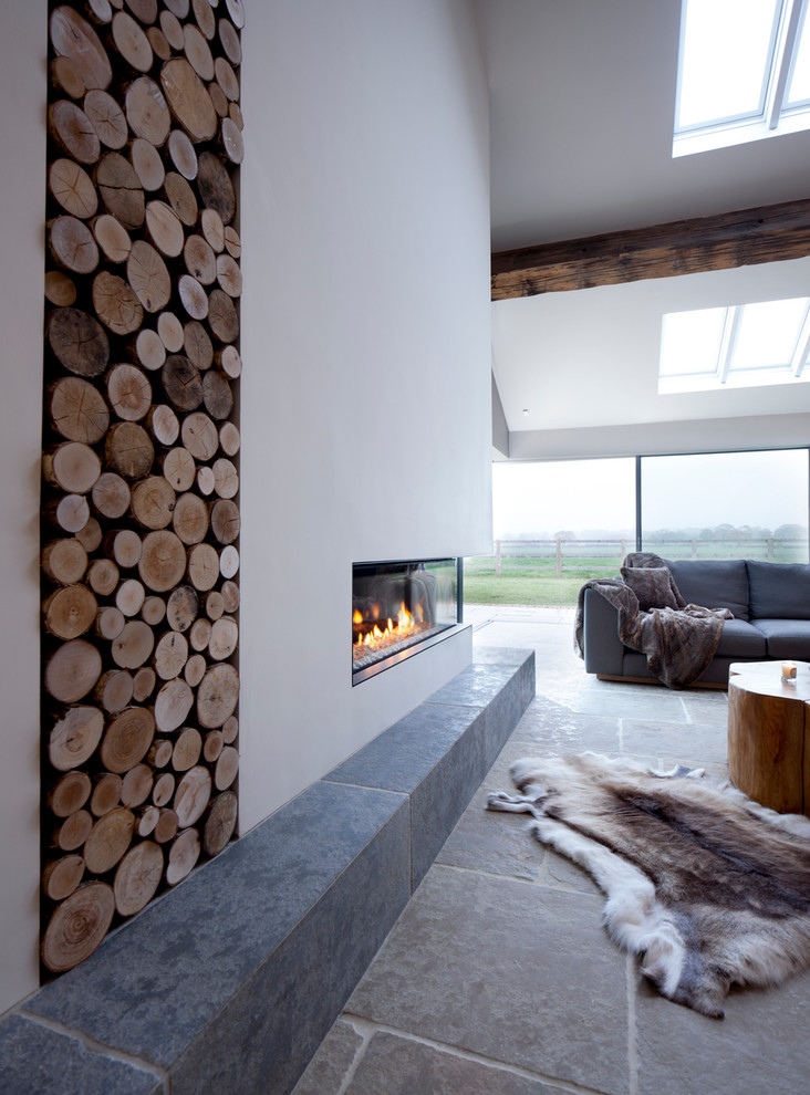 Trendy open concept living room photo in Manchester with white walls and a ribbon fireplace