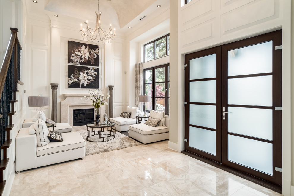 Mid-sized elegant formal and open concept beige floor and marble floor living room photo in Vancouver with white walls, a standard fireplace and no tv