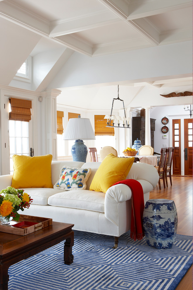 Inspiration for a timeless brown floor living room remodel in Miami with white walls