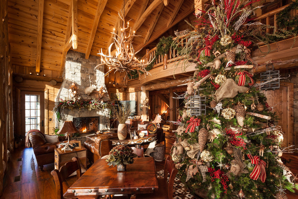 Inspiration for a rustic formal and open concept brown floor living room remodel in Atlanta with brown walls, a standard fireplace, a stone fireplace and no tv