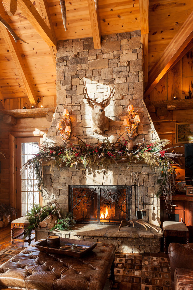 Mountain style formal and open concept brown floor living room photo in Atlanta with brown walls, a standard fireplace, a stone fireplace and no tv
