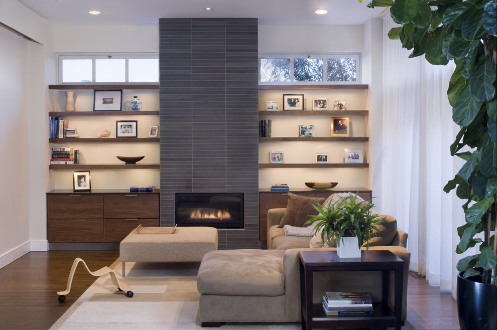 Living room - contemporary living room idea in San Francisco with a tile fireplace