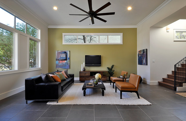 Trendy Living Room Photo In Austin With Yellow Walls And A Wall Mounted Tv