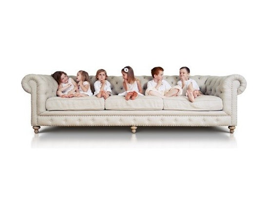 Cigar Club Tufted Linen Sofa - Stylish and comfortable, this Cigar Club sofa will bring an exciting notion to your home decor. Sofa is designed in the classic Chesterfield style with eco-style linen and hand-hammered shoe nails. Quality construction is found throughout featuring a hardwood frame and eight-way hand tied suspension. Back cushions are 50% feather and down and 50% polyfiber wrapped around a 4.5 inch foam core to ensure a comfortable experience. Available in three sizes.