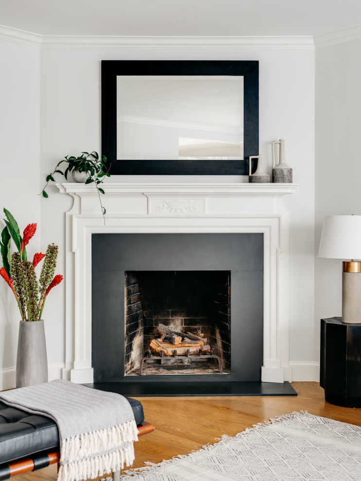 Living room - mid-sized transitional formal and open concept medium tone wood floor and brown floor living room idea in San Francisco with gray walls, a corner fireplace, a wood fireplace surround and a wall-mounted tv