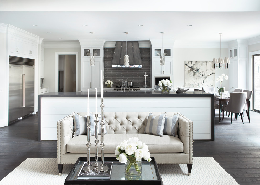 Example of a large transitional open concept dark wood floor living room design in Charleston with white walls