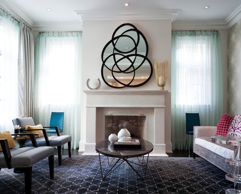 Transitional living room photo in Toronto with beige walls and a standard fireplace