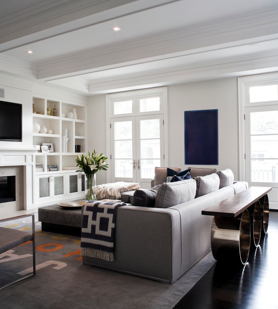 Inspiration for a transitional living room remodel in Toronto with white walls and a media wall