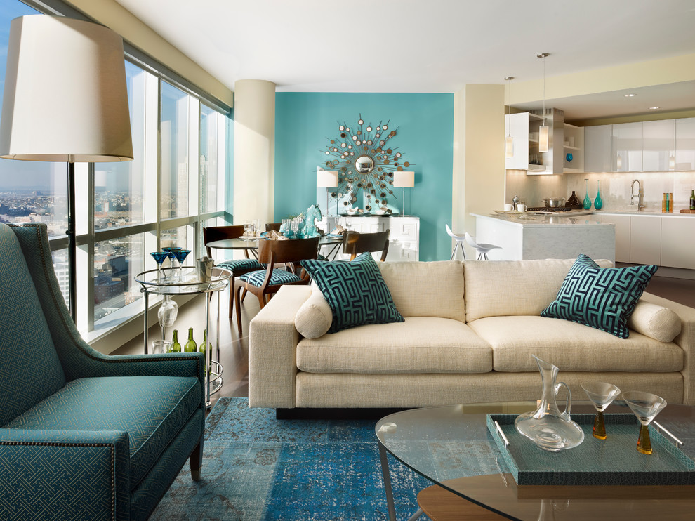 Small trendy open concept living room photo in New York with blue walls