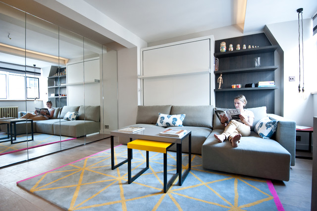 Small Trendy Enclosed Light Wood Floor Living Room Library Photo In London With Gray Walls And