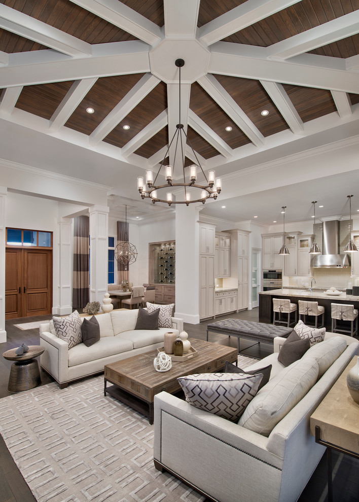 Inspiration for a transitional open concept dark wood floor living room remodel in Miami with white walls