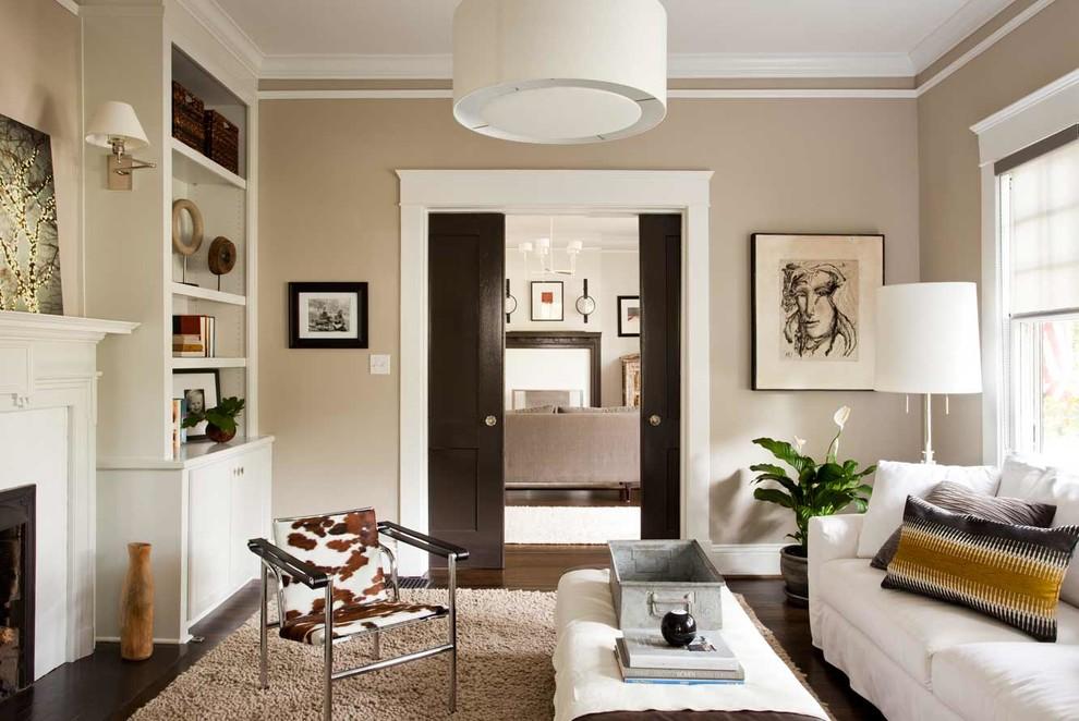 Living room - mid-sized contemporary enclosed dark wood floor living room idea in Atlanta with beige walls