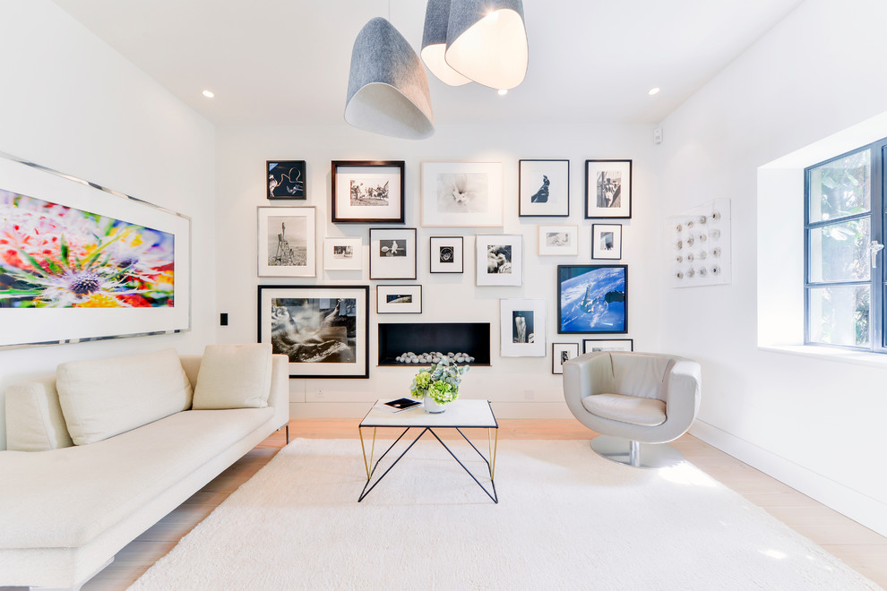 Large urban living room photo in London with white walls and a ribbon fireplace