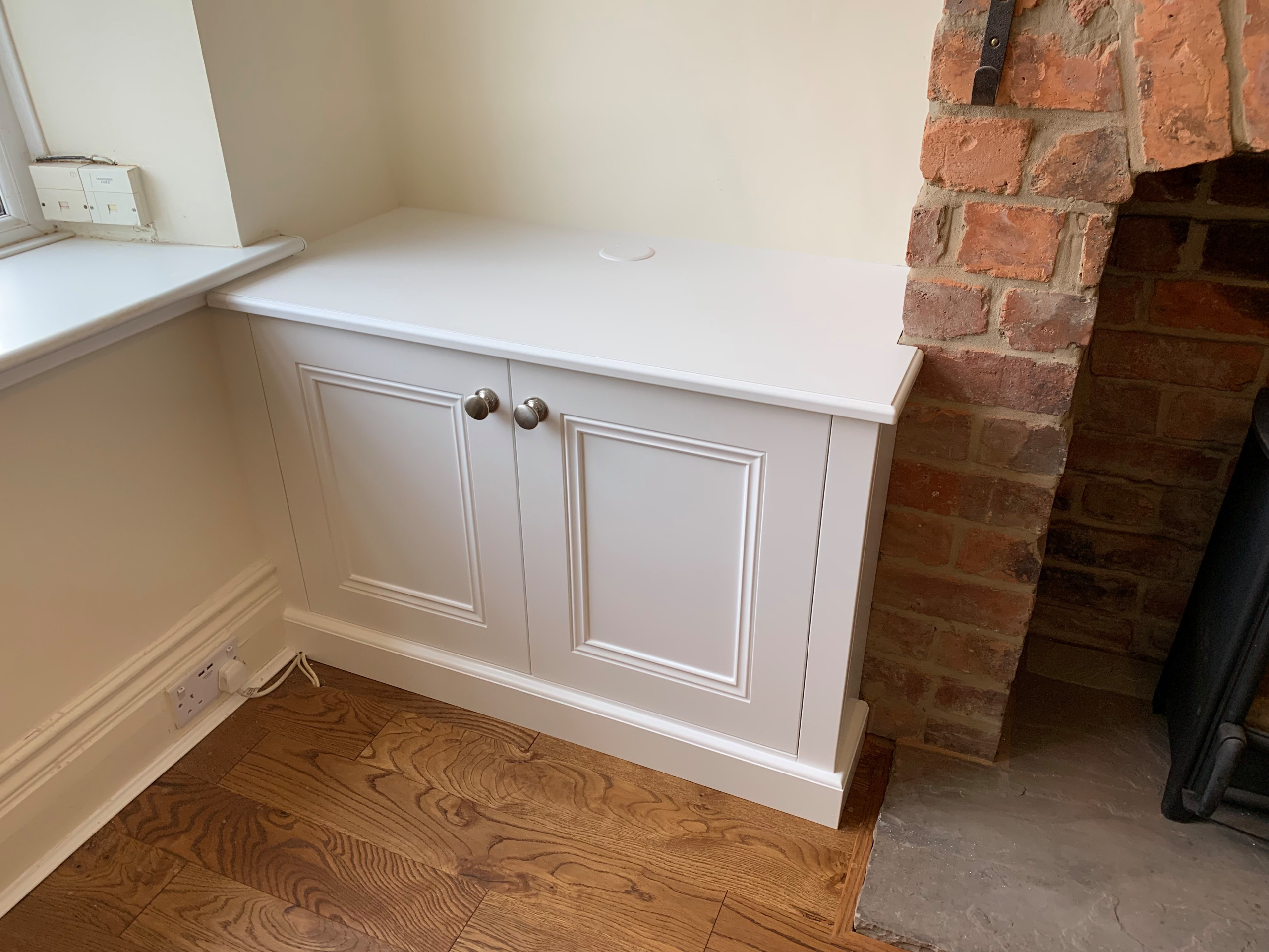 Classic Alcove Base Cabinet Against Rough Brick Chimney Breast