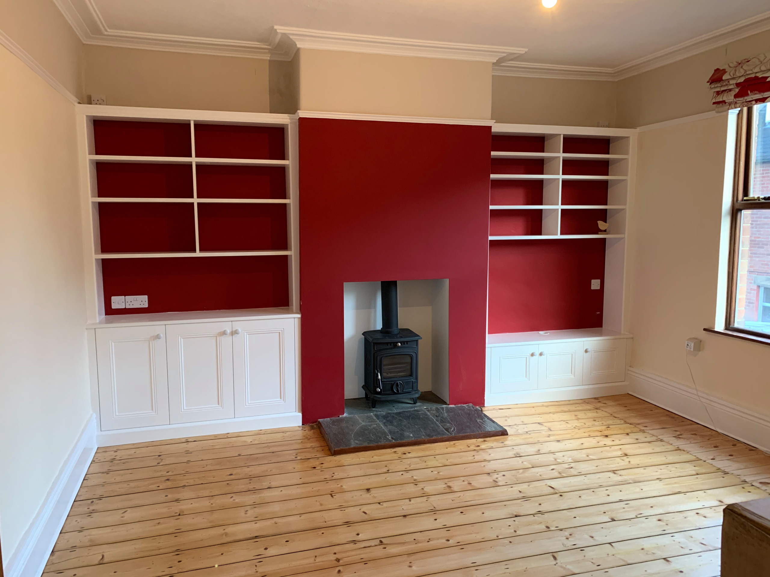 Classic Alcoves with Backless Bookcases Against a Red Wall
