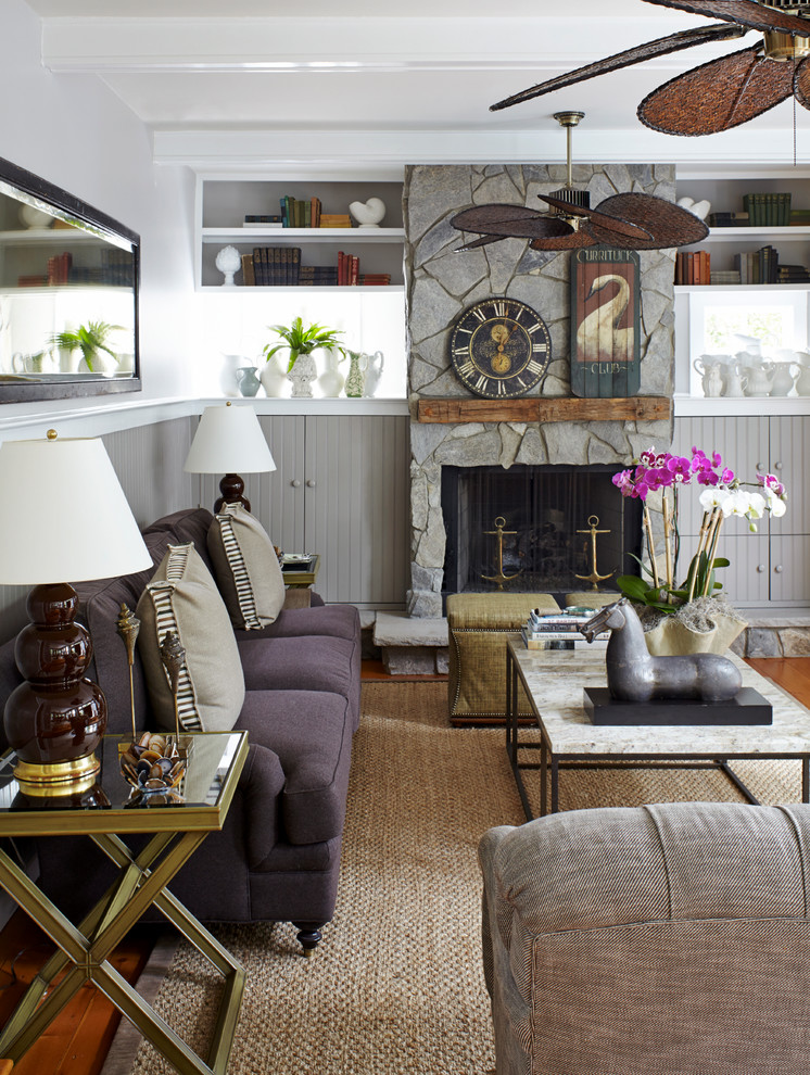 Inspiration for a coastal formal medium tone wood floor living room remodel in New York with a standard fireplace, a stone fireplace and white walls