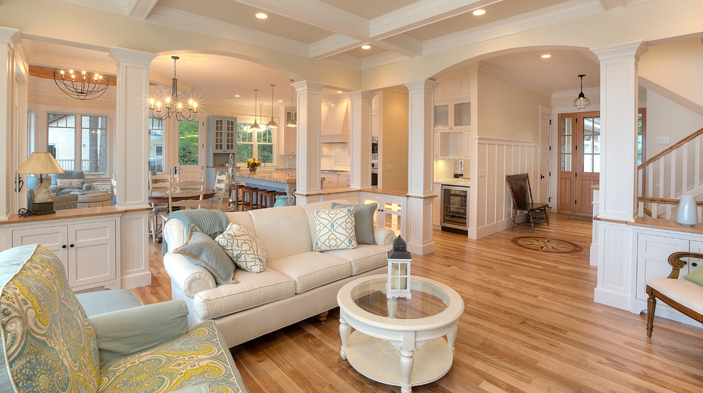 Example of a classic open concept coffered ceiling living room design in Other with beige walls