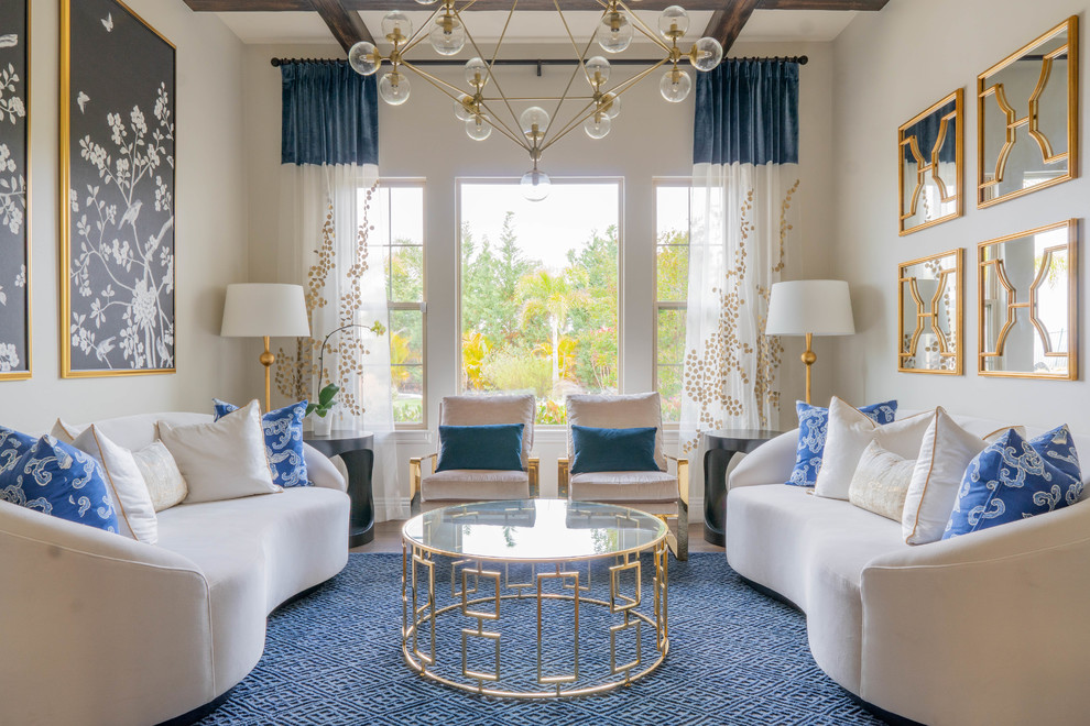 Inspiration for a transitional formal light wood floor and beige floor living room remodel in San Diego with white walls and no tv