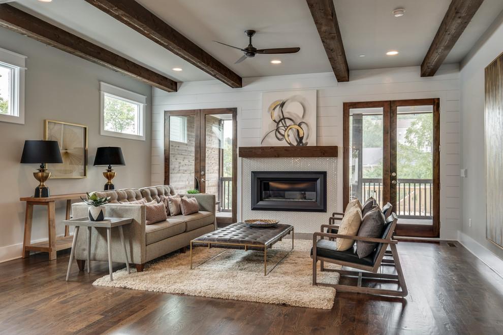 Ejemplo de salón abierto, tradicional renovado, de tamaño medio, con paredes grises, suelo de madera oscura, todas las chimeneas y marco de chimenea de baldosas y/o azulejos