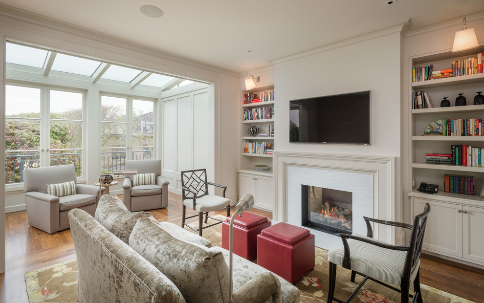 Elegant living room photo in San Francisco with a standard fireplace and a wall-mounted tv