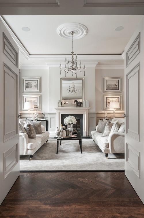классика в интерьере белого цвета дубовый паркет камин два дивана картины
