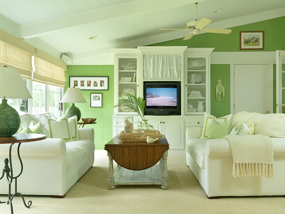 Mid-sized elegant enclosed carpeted living room library photo in Other with green walls, no fireplace and a media wall