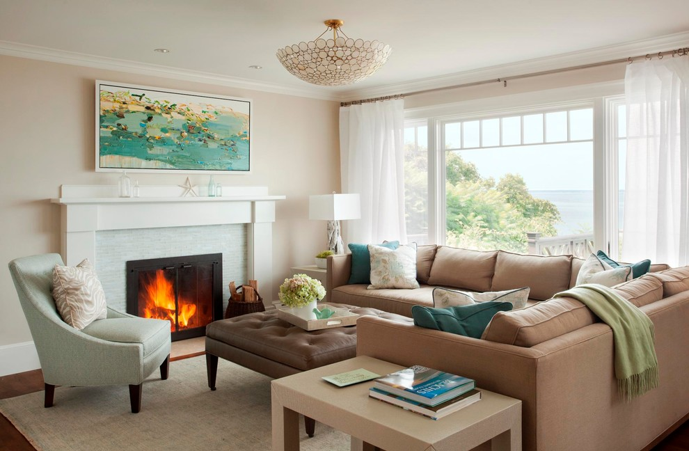 Living room - large beach style open concept medium tone wood floor living room idea in Boston with a standard fireplace, a tile fireplace and beige walls