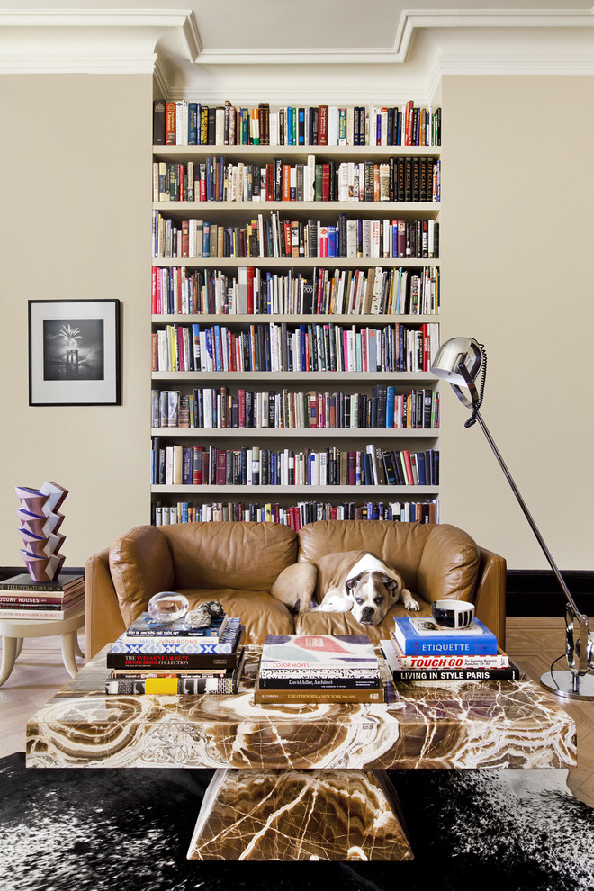 Eclectic living room library photo in New York with gray walls